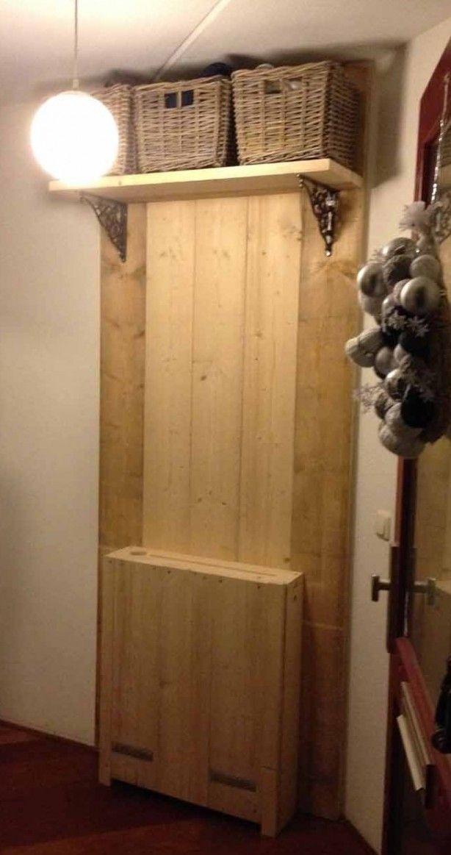Kapstok en radiatorombouw van steigerhout, nu de haken er op en hij is klaar!