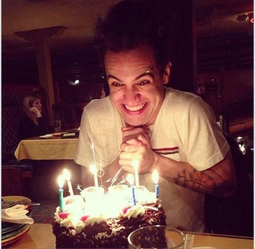 Looks like he's plotting something evil with that cake.  panic! at the disco Brendon Urie
