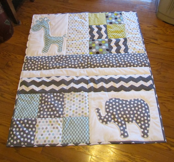 Grey and white baby elephant and giraffe baby quilt. Handmade Baby Quilt with elephant and giraffe applique. $120.00, via Etsy.