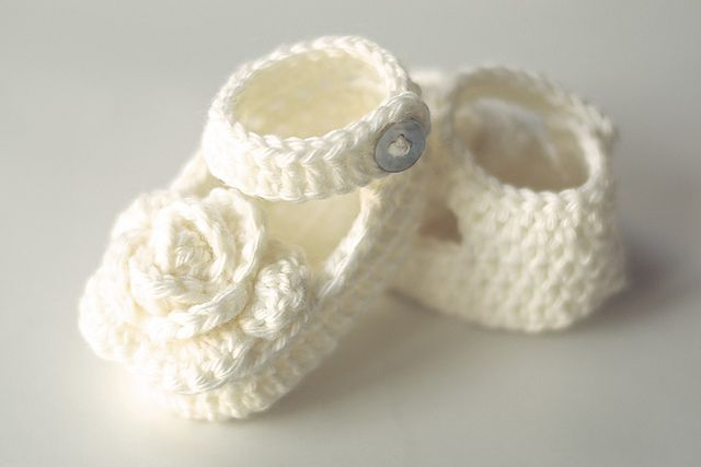 Ravelry: Crochet Newborn Rose Booties pattern - not free, but love the cream color with the rose detail