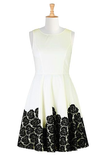 Contrast floral lace lends textural dimension to our darling sleeveless poplin dress finished with a flouncy flared skirt.