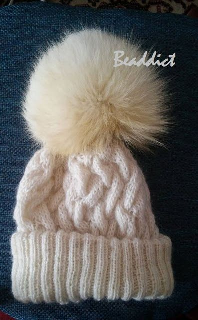 Knitted hat with fur bobble. Designed and made by Beaddict. Wool yarn, old fur collar, fox fur.