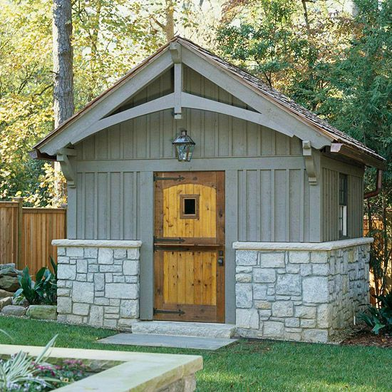 This garden shed is AMAZING!  LOVE that two-part Dutch door & the stone of the lower walls & the balustrades supporting the elegant roofline!  And I even love the little cute light above the door!  Perfectly adorable.   <3