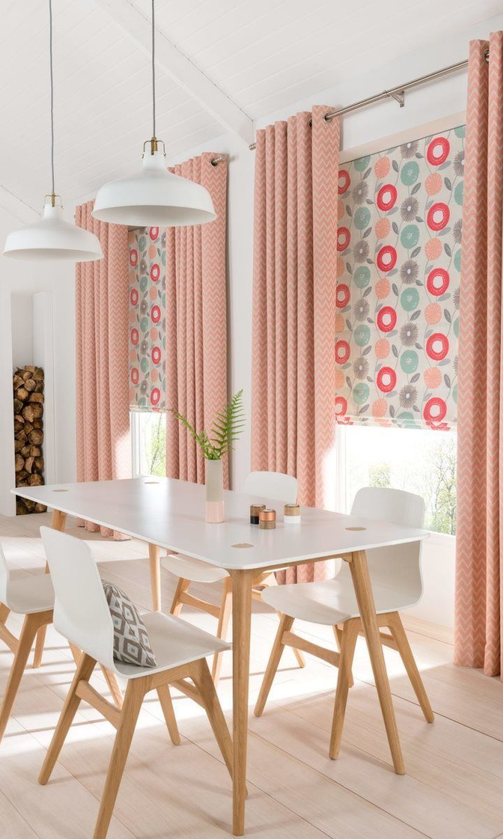 White and natural wood shades create the perfect Scandi theme, pair this with bright pops of colour such as pink in soft furnishings such as Horizon Salmon made to measure Curtains and Freyja Coral Roman blinds add a lovely finishing touch. www.hillarys.co.uk