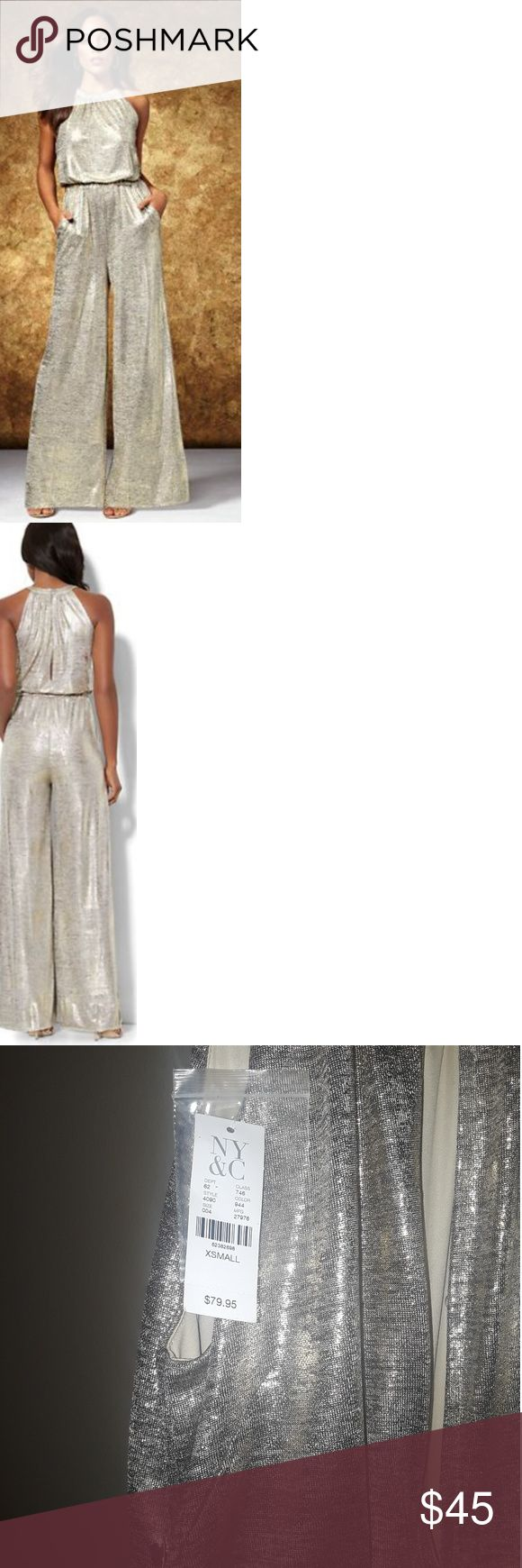 Gorgeous New York and Company Metallic Jumpsuit Metallic-foil mock neck jumpsuit by New York & Company. Purchased for an event but never wore it. Super cute open back. Listing color as gold but is metallic...XS/Size 2. New York & Company Pants Jumpsuits & Rompers