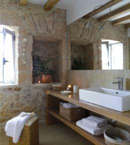 Casas de banho rústicas por Deu i Deu
