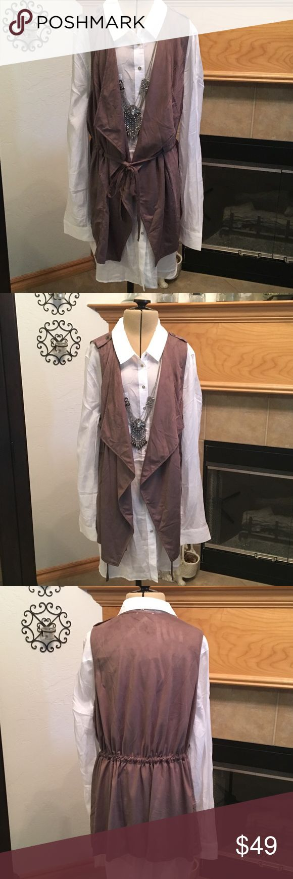 """SLEEVELESS SUEDE OPEN FRONT VEST WITH DRAW STRING SLEEVELESS SUDEDE OPEN VEST WITH DRAW STRING TIE-55% COTTON-45% POLYESTER-VERY SOFT-DRAP FRONT-SMALL-SHOULDERS ARE ABOUT 12""""-ARMHOLE DISTANCE IS ABOUT 18""""-LENGTH IS ABOUT 27 1/2""""-MEDIUM-SHOULDERS IS ABOUT 12 1/2""""-ARMHOLE DISTANCE IS ABOUT 20""""- 28""""-LARGE SHOULDERS IS ABOUT 13""""-ARMHOLE DISTANCE IS ABOUT 20 1/2""""-LENGTH IS ABOUT 29""""THE COLOR IS CALLED RED BEAN BUT IT IS A LIGHT MOCA BROWN Umgee Jackets & Coats Vests"""