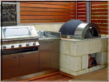The Zesti pizza oven with barbecue in an enclosed outdoor area.