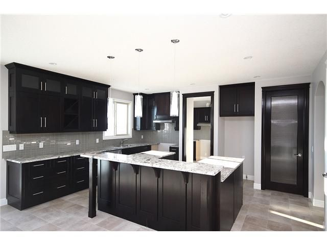 Light Gray Kitchen With Dark Cabinets kitchen - dark cabinets, lighter grey walls | reno/home