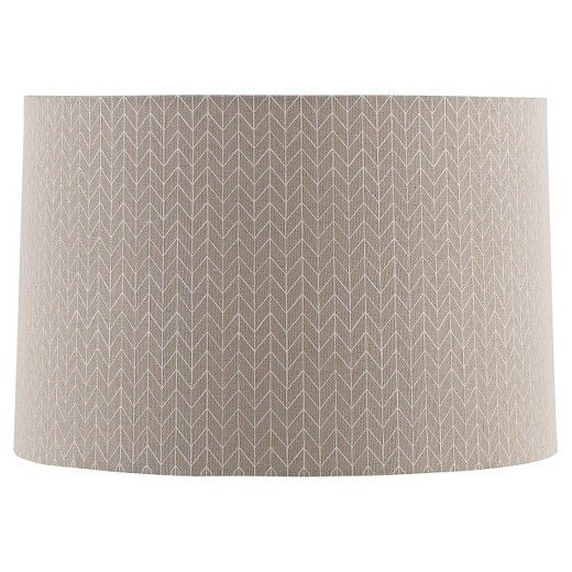 Create your own décor with the Straight Drum Outline Chevron Lamp Shade Large - Beige with Cream Detail - Threshold™. Add a fresh touch to your tired old décor by changing the lampshade on a favorite lamp base or start out with a mix and match style that is uniquely yours. You'll love the options you now have to let your personal aesthetic shine.