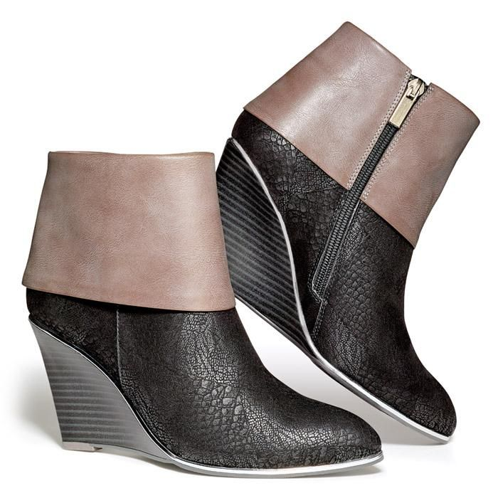 "Take your look to new heights—with no fear of teetering!—by wearing these wedge booties featuring a stunning mashup of colorblocking and mixed textures accented with a supercool silvertone rim. 3"" heel.Whole Sizes: 6-10Half sizes order up."