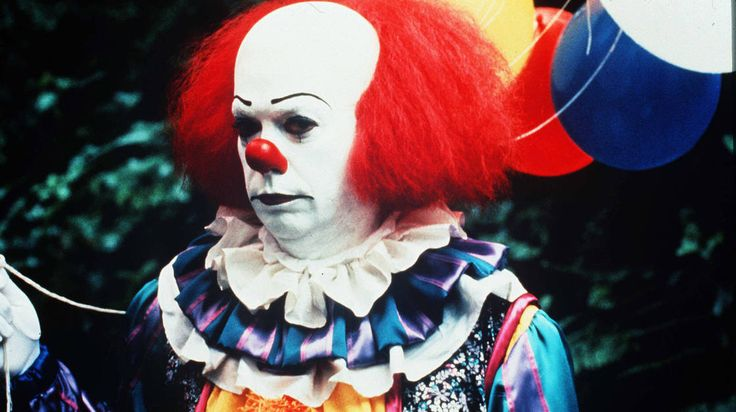 Tim Curry as Pennywise in a 1990 TV adaptation of Stephen King's It. Come on, tell us you aren't just a little creeped out. NPR