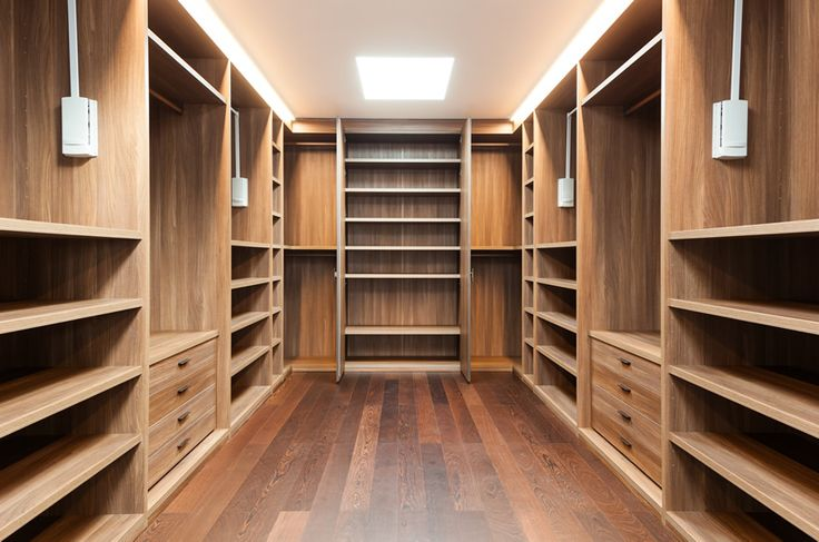 Walk in closet with wood flooring