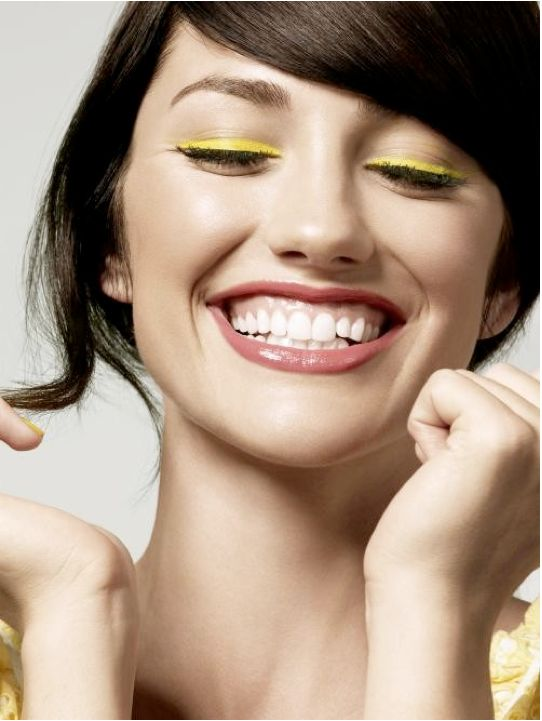 We are a huge fan of a pop of neon in our face makeup this Spring.