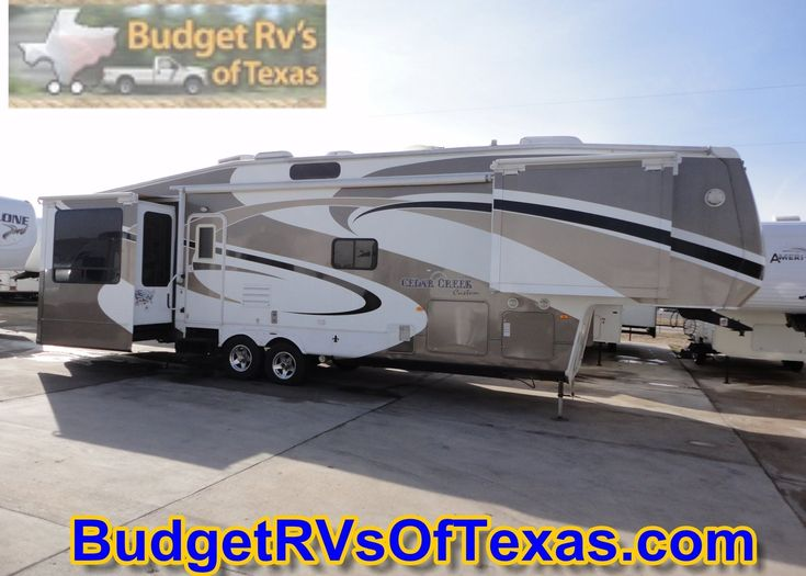 2009 38ft Cedar Creek Custom 5th Wheel Travel Trailer Relax in the cozy living room in an OH So Comfortable recliner and watch your favorite show or team while the built in fireplace sets the mood. A king size master with dedicated A/C will ensure you get a great nights rest! No need to find a coin operated laundry on your trips as this one is equipped for a washer/dryer! See more at BudgetRVsOfTexas.com