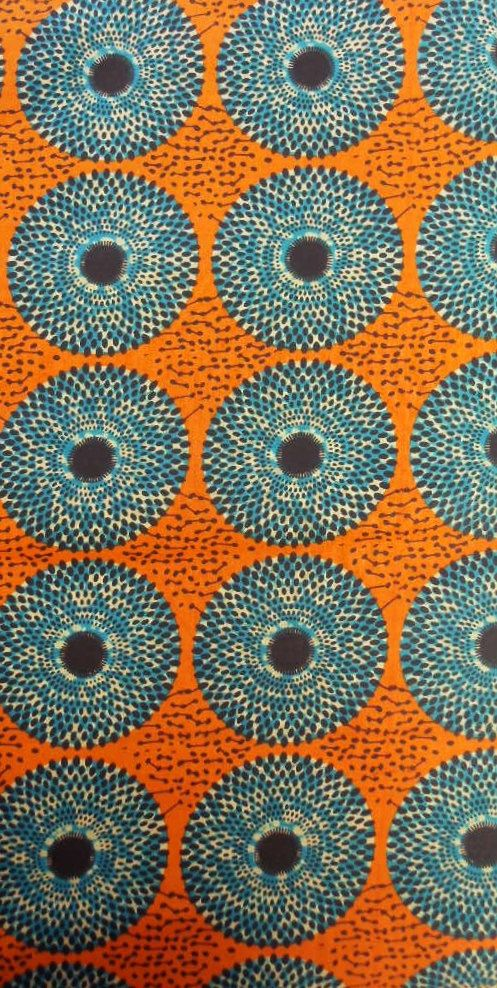 Orange & Blue Circular Design African Print Fabric (sold by the yard) via Etsy