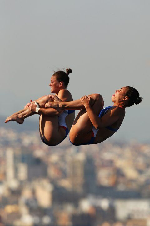 Samantha Bromberg and Cheyenne Cousineau of USA compete in the Women's 10m Springboard Diving final on day three of the 15th FINA World Championships at Piscina Municipal de Montjuic on July 22, 2013 in Barcelona, Spain. (Photo by Clive Rose/Getty Images)