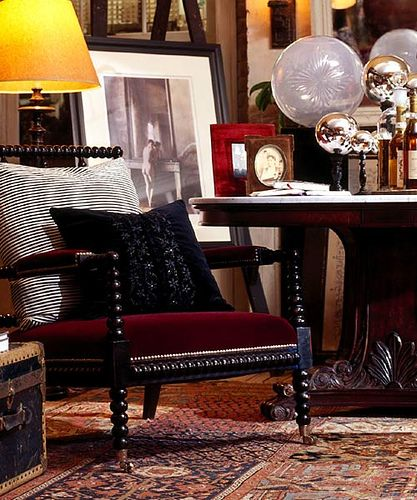 Ralph Lauren, New Bohemian Collection -- i especially like the layering of fabrics on the chair.