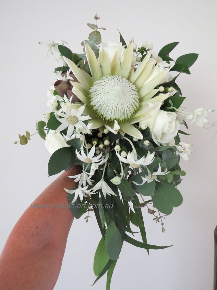 Beautiful, elegant, trailing white bouquet , wild flowers, australian natives and south african protea, perfect for a country theme wedding or any wedding, timeless.  #whiteflowers #trailing bouquet #protea #natives #bride #bouquet #country #chic #wildflowers, #australiannatives #protea