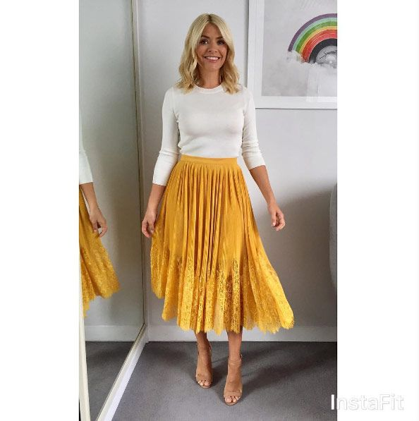 holly willoughby | Holly Willoughby blows fans away with flowy mustard Whistles skirt on ...