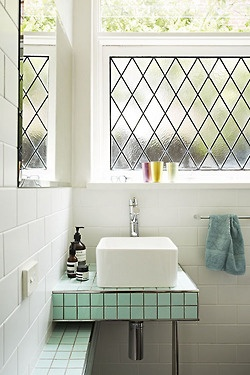 what a cute little bathroom! love the harlequin window panes and aqua tiles.