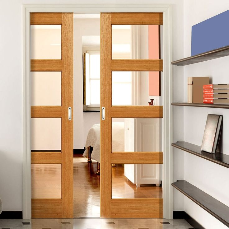 Double Pocket Humber Oak sliding door system in two size widths with Clear Glass. #moderndoors #pocketdoors #contemporarydoors