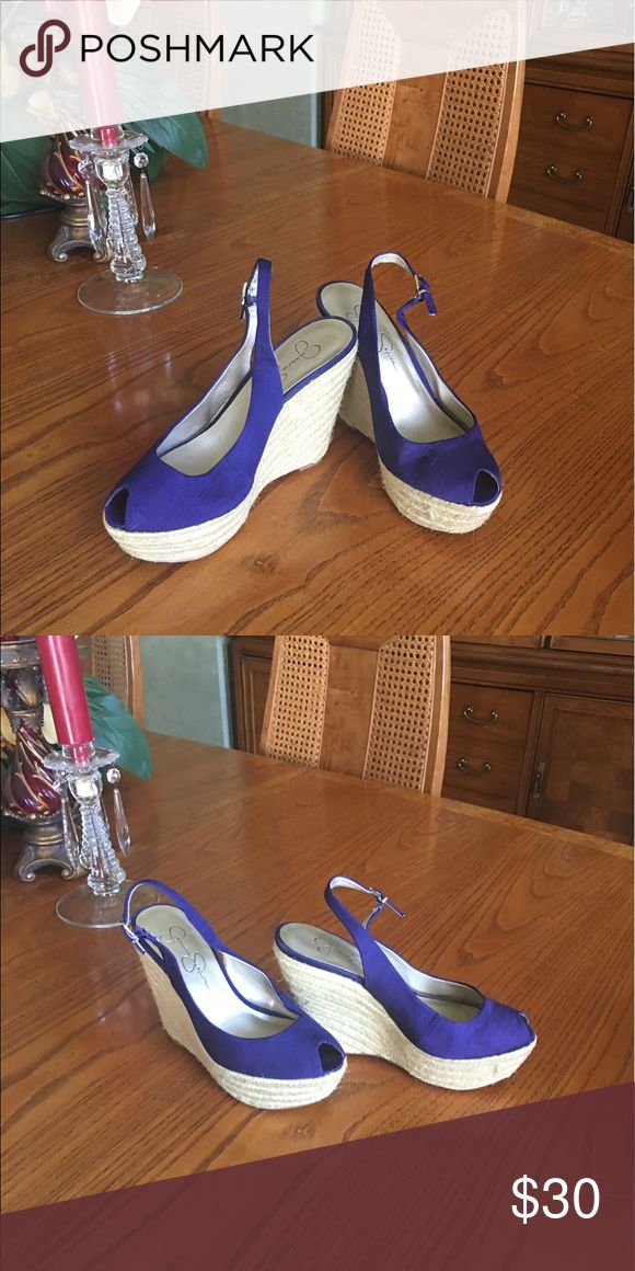 Jessica Simpson wedge shoes Like new bright navy blue fabric wedge with raffia platforms. Worn twice on a cruise and no sign of wear other than soles Jessica Simpson Shoes