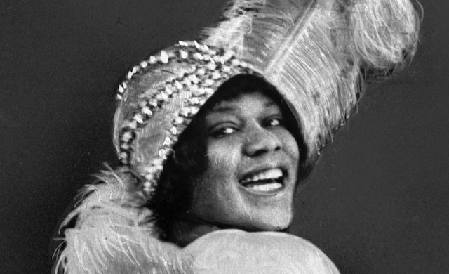 """In 1923, Smith was signed by Columbia Records as part of their """"race records"""" series and she scored a hit with her first recording """"Downhearted Blues"""" which sold 780,000 records in the first six months after release."""