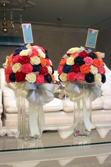 Tall vase cupcake bouquet, in wedding colours, maybe with some jewels set in between the cupcakes or cake balls :)
