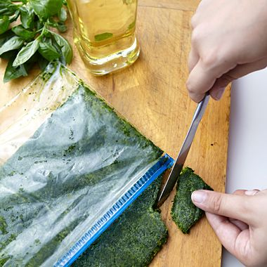 Wash herbs, discarding stems and damaged leaves.  dry well with paper towels. Place herbs in food processor 1/3C olive oil to 2 herbs Pulse processor, until you get a chunky paste and all leaves are chopped put 1 cup herb oil in a 1qt ziploc Freeze flat. Best used within 6 months.
