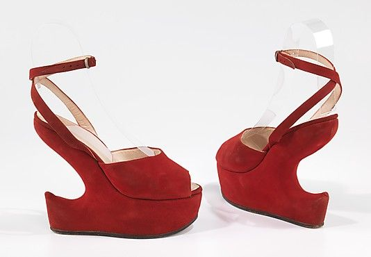 Circa 1940 Victor leather platform sandals. While platform shoes are typically associated with the 1940s and 1970s, they first came in to modern fashion in the late 1930s, with many of the most innovative and inventive treatments tried between 1937 and 1942. The undercut heel was introduced by designer Seymour Troy in 1939, and is here stylized into a dramatic S-shaped focal point.  Via The MET.