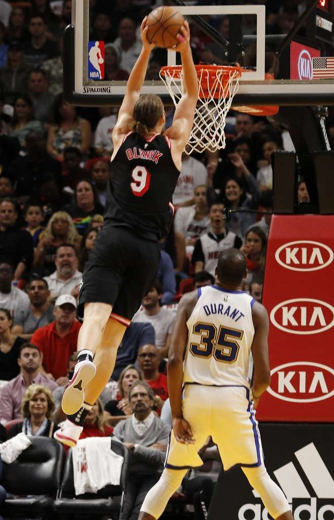 Miami Heat center Kelly Olynyk (9) dunks over Golden State Warriors forward Kevin Durant - Warriors ride big third-quarter past Heat - SFGate