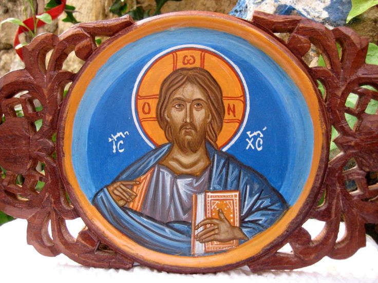 The Lord All Mighty, the actual translation of the greek word Pantocrator - in a circular representation inspired by a Dome of a church in Mt Athos A most amazing representation of the Lord iin a carved wooden frame and an sky blue background The thin round icon is approx 18 cm in diameter . The carved wooden panel was specially treated with gesso and sandpapered to acquire a surface for painting. Several layers of egg tempera where applied and finally shellac and wax varnish have sealed the…