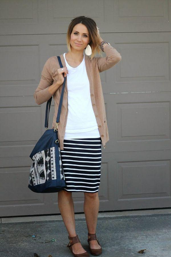 Camel boyfriend cardigan, navy striped skirt, ankle strap flats