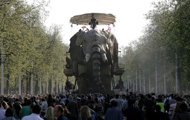 "Hundreds of people watch a giant mechanical elephant walk down the Mall in London in an outdoor performance of ""The Sultan's Elephant"" by Royal de Luxe, on May 5, 2006. The story told of a Sultan who dreamed about a little girl and traveled in his elephant time-machine in search of her."