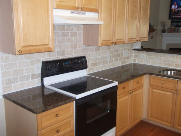 kitchen stone tile brown granite countertops with subway tile backsplash 3113
