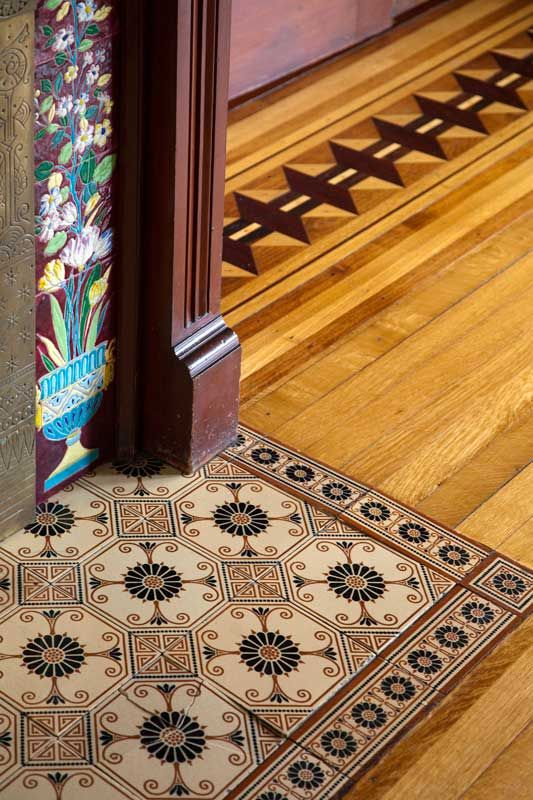 Love the inlaid tiles and wood floor