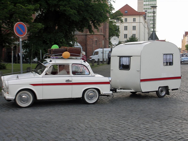 Red & white Trabant P50 and matching wohnwagen. Zwickau, Germany