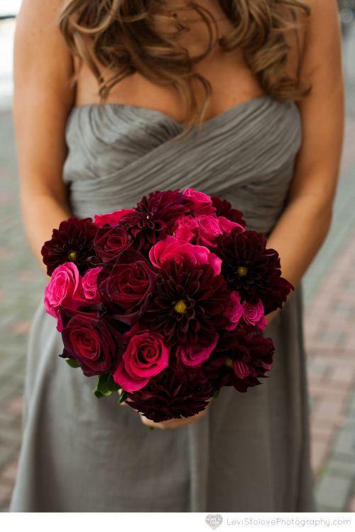 Black roses and magenta roses in dahlia bouquet bridesmaid