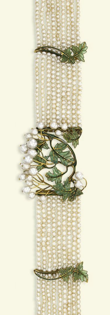 AN ART NOUVEAU PEARL AND ENAMEL CHOKER. The central curved panel designed with green plique à jour enamel foliage and natural pearl berry clusters to the nine-row pearl choker with foliate spacers and clasp, circa 1900. #ArtNouveau #choker