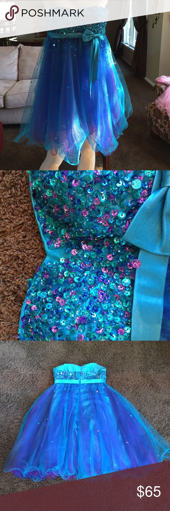 Blue and Purple Homecoming Dress Beautiful dress! Some of the beading is missing (as shown in picture 2) but can easily be fixed and still in great condition. It was only worn 2-3 times. Make me an offer! Hannah S Dresses Prom