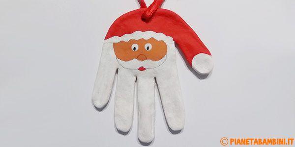 Babbo Natale con pasta di sale e impronta della mano