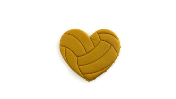 This is a 3D Printed Cookie Cutter in the shape of a heart with a VolleyBall pattern stamp imprinted on the cookie. This item was made using food