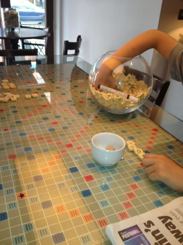 Place scrabble boards under a sheet of glass on your coffee table and fill a bowl with the letters!  This looks like fun :)  A chess board would be nice too  And other fun board games like that  Plexiglass is probably good table cover and good to cover puzzles half put together too