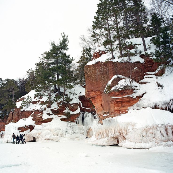 Cathedrals of Ice | The New Yorker - this past February, thanks to an unusually cold winter, the sea caves along the Apostle Islands National Lakeshore, in northern Wisconsin, were accessible by foot for the first time in five years. Visitors were able to walk two miles over the thick ice of Lake Superior to see the ice formations that run up the coastline. Erin Brethauer, a photographer living in North Carolina, visited the sea caves with her father.