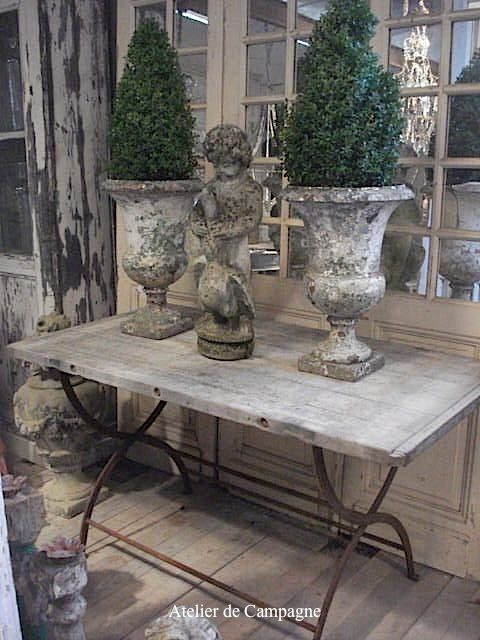 Boxwood in old French urns by roseann