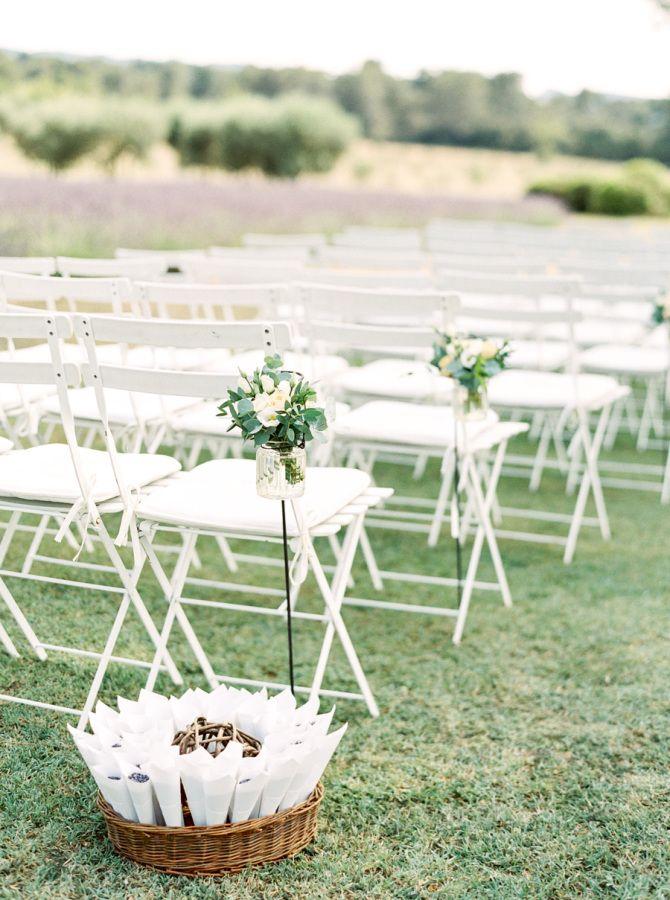 Classic wedding flower decor down each aisle: http://www.stylemepretty.com/2016/11/11/provence-france-destination-wedding/ Photography: Cody Hunter - http://codyhunterphotography.com/