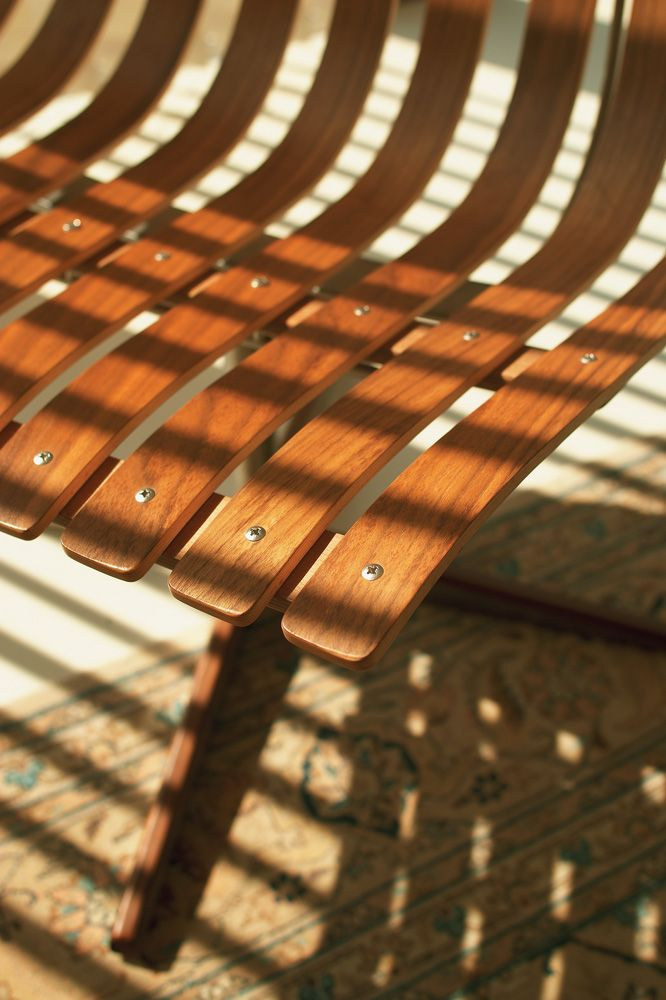 Beautiful silhouette from a Luxaflex wood venetian blind across a chair.  #chair #wood #blinds #luxaflex