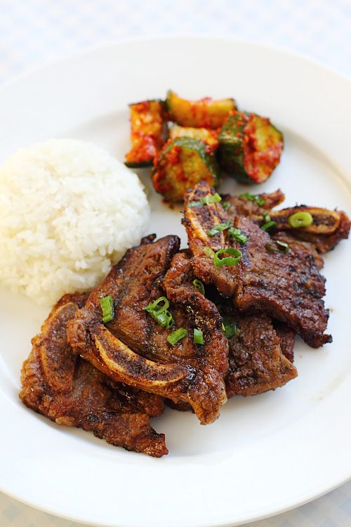 Mmm, the perfect dinner - Kalbi (Korean BBQ Beef Short Ribs with rice and kimchi cucumbers)