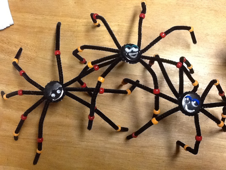 Meet the bottlecap spiders I made for my 3 rd graders Halloween Party craft.